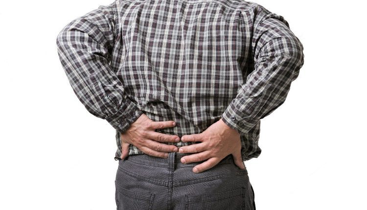 blog picture of man grabbing lower back in pain
